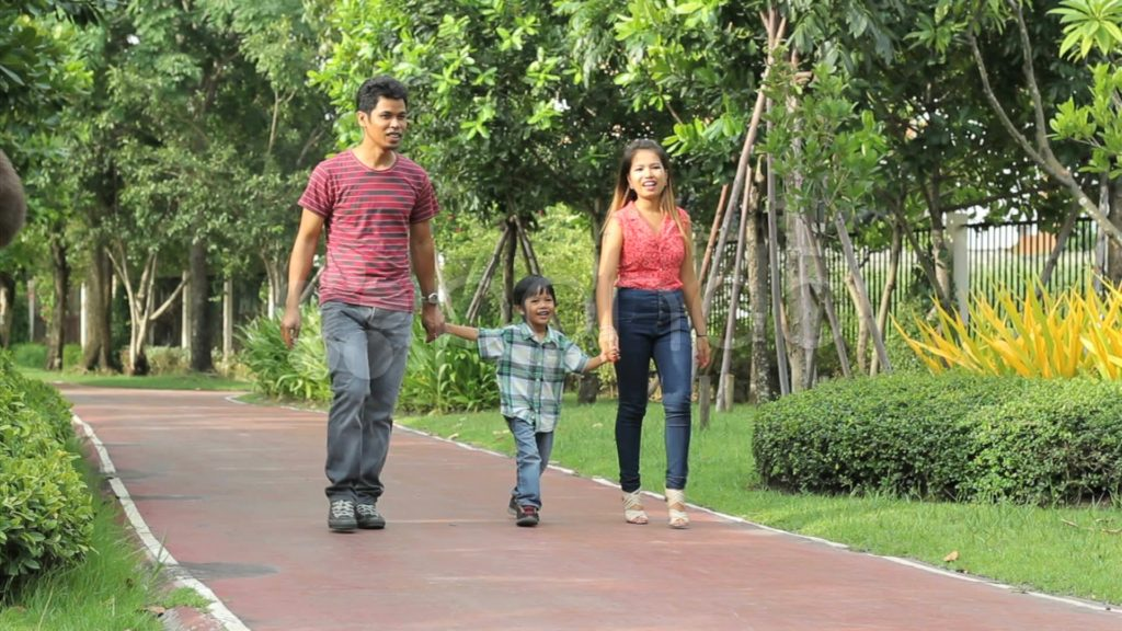 Family enjoying a walk in the park helps to reduce anxiety