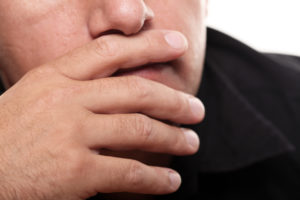 Male Hand on Mouth. Contemplating